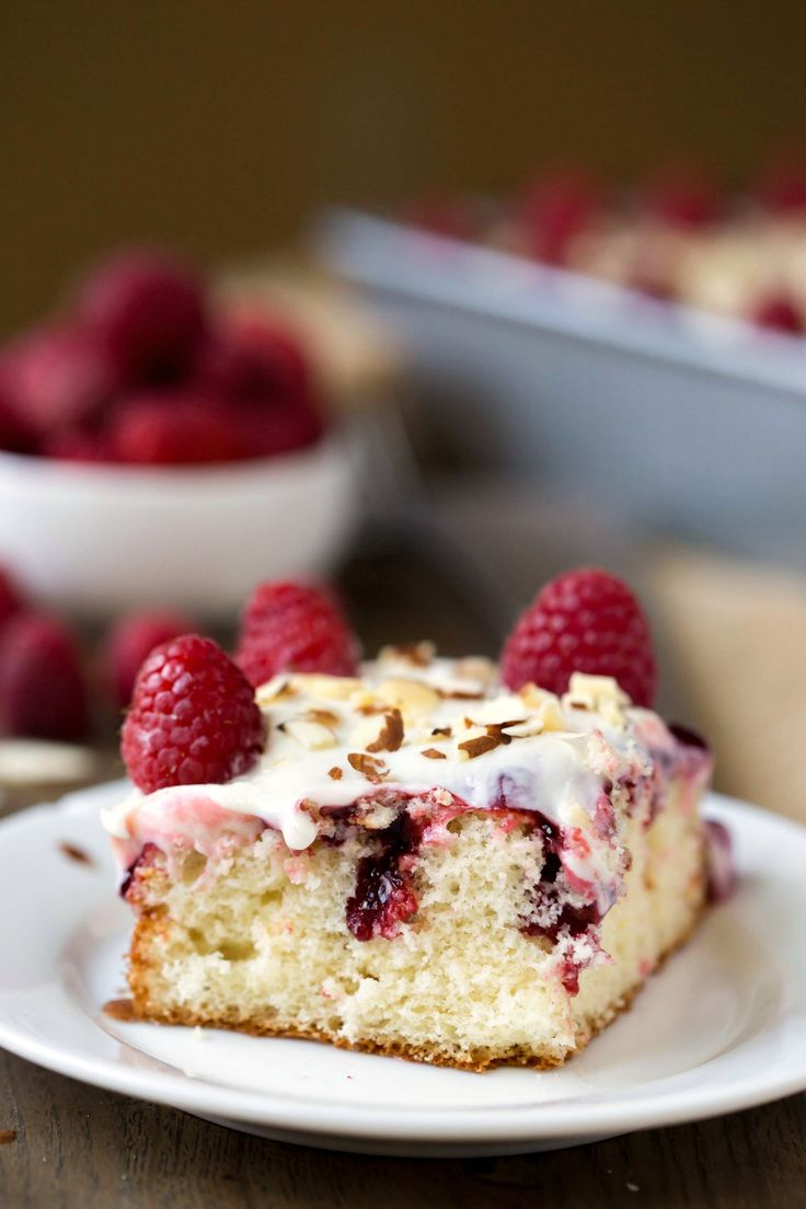 White Raspberry Poke Cake tastes just like white wedding cake but is so much easier to make! This is the best potluck dessert recipe!