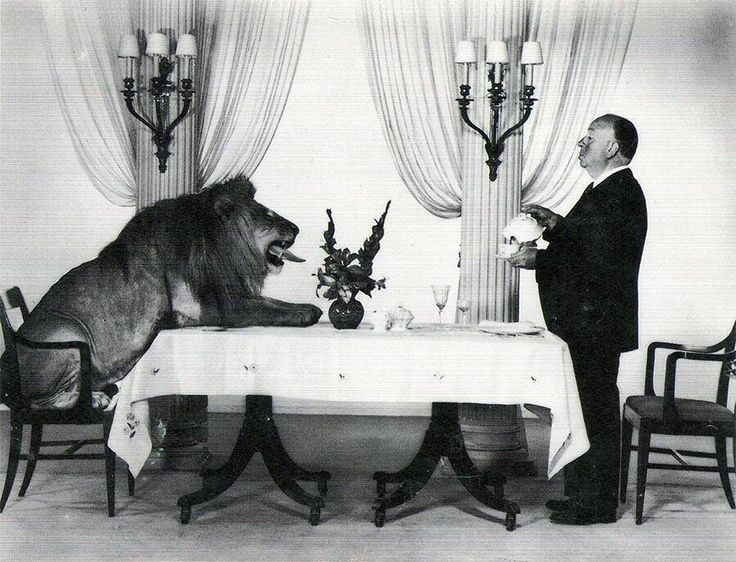 Alfred Hitchcock serving tea to Leo the Lion, MGM's mascot, 1958 http://www.historicalphotographs.net/