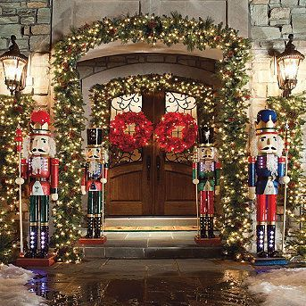 I want a Christmas entrance like thise one! Christmas Lights & Nutcrackers  #Christmas