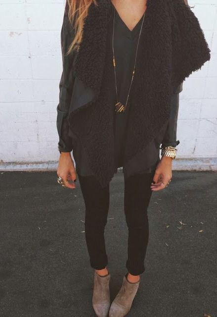 A shearling lined waterfall vest adds dimension and texture to an all black fall ensemble.