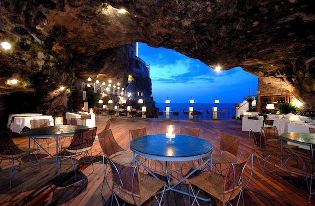 """In this gorgeous limestone cave in Italy, you'll find a restaurant with an unbeatable location and views of Adriatic Sea.Known as """"The Summer Cave"""" this spot is part of theBoutique hotel Grotta Palazzese located in Polignano a Mare."""