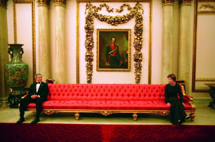 President George W. Bush and Mrs. Laura Bush sit on either ends of a couch prior to a social event at Buckingham Palace.  Photo by Eric Draper, Courtesy of the George W. Bush Presidential Library and Museum Photo: Eric Draper