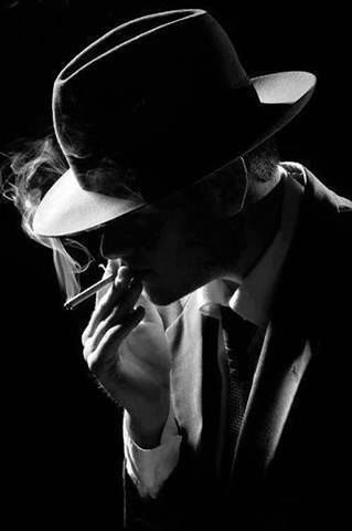 """This is a picture of what a 1930's Hollywood Gangster looks like. I chose this picture because in the book Monster, the gang members are nothing like this """"gangster"""". The gangsters in Monster and guys who wear oversized shirts with either blue as their main color, or red.:"""