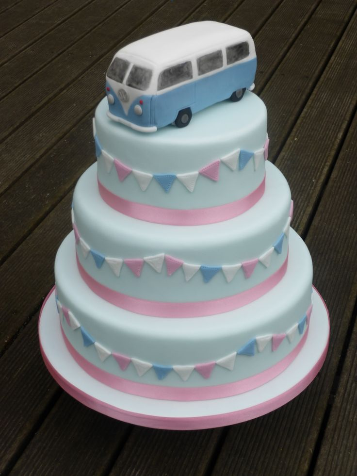 VW Camper Van topper on pale blue 3 tier cake with pink, white and blue bunting decoration.