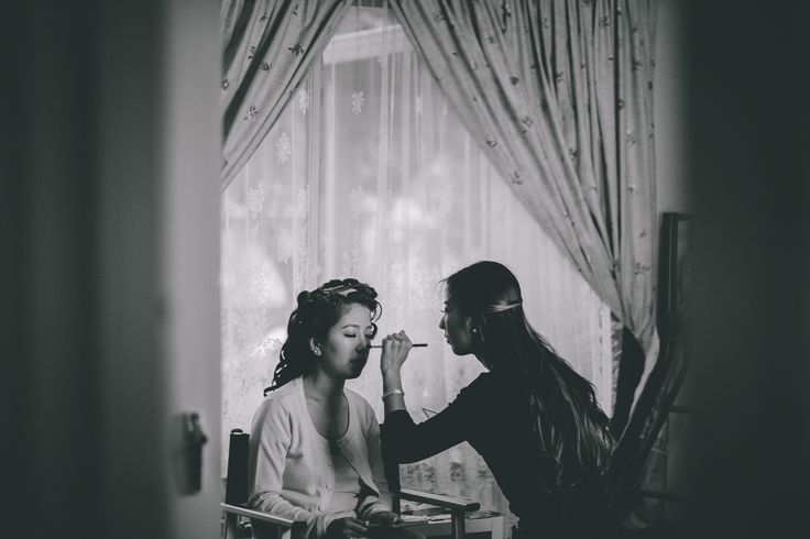 Wedding makeup prepped in a bedroom in the bride's parents house. / Gold and Grit Photography