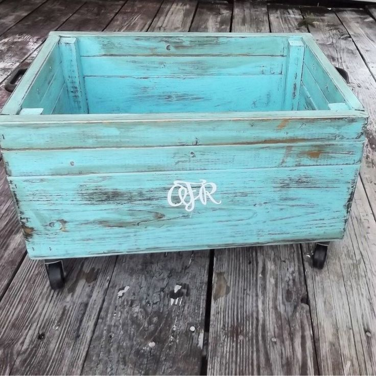 Handmade storage bin with rolling wheels and finished in a distressed chic look