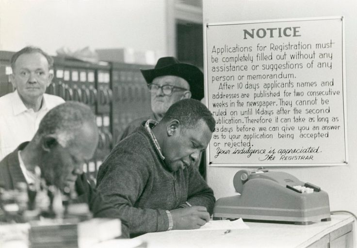 Black citizens filling out voter-registration forms at Forest City Courthouse Hattiesburg, Mississippi, January 22, 1964 Photograph by Matt Herron