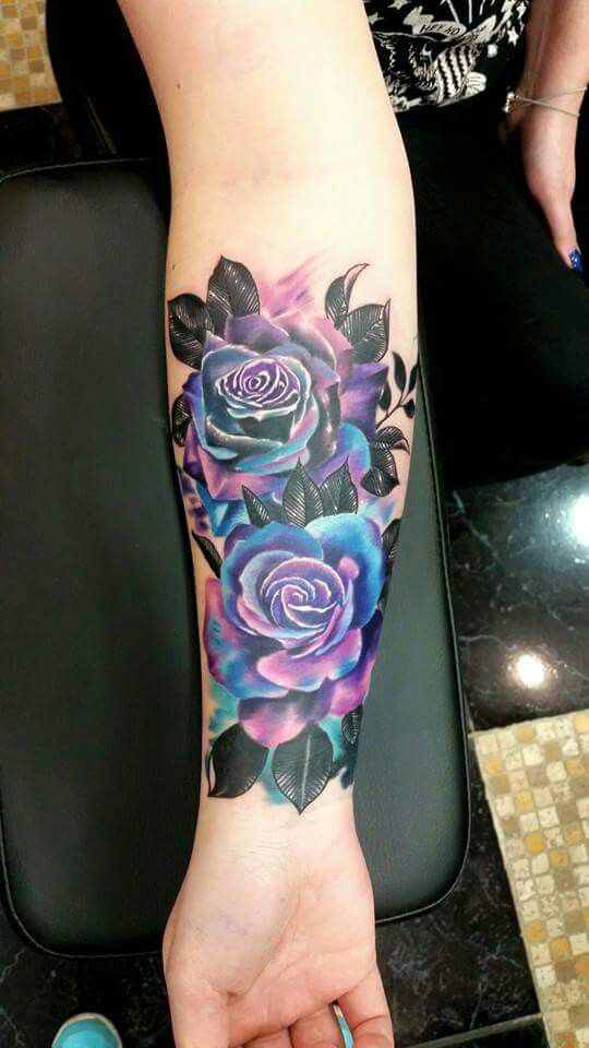 Galaxy Color Roses Tattoo. The leaves are way too dark but the roses are beautiful.
