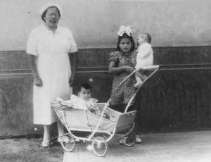 Lina Medina, holding her doll, a few months after delivering her baby boy, Gerardo.