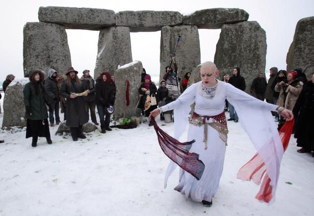 How to Celebrate Yule, the Winter Solstice: Druids celebrate the winter solstice each year at Stonehenge.