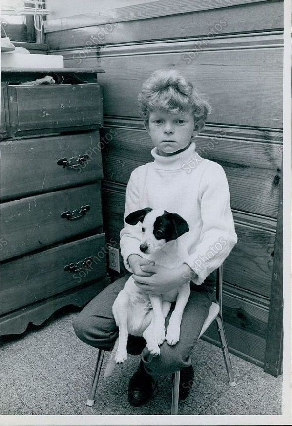 0 young Johnny Whitaker with a little dog on his lap