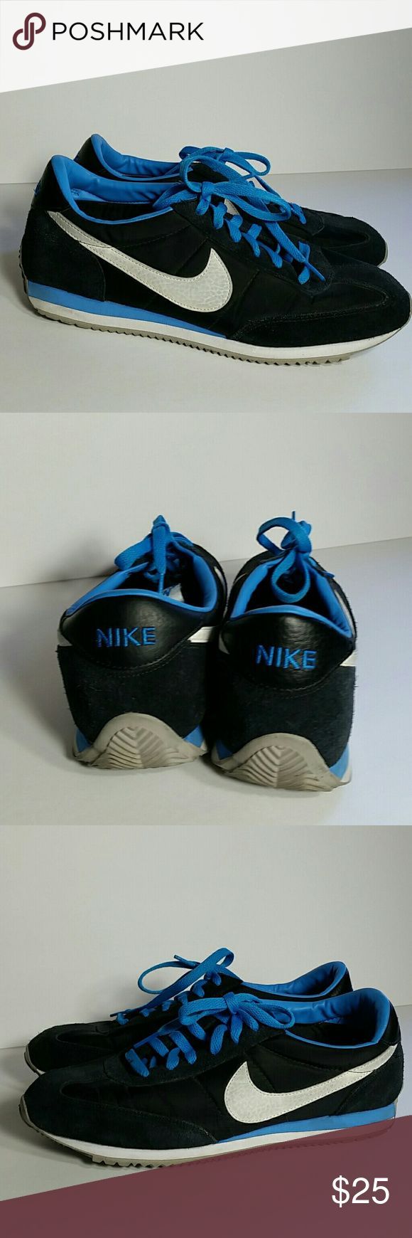 NIKE Oceania Retro Sneaker Low Top Shoes Size 11 Womens black and blue low top retro nike Oceania shoes. Black with white swoosh side logo, blue laces and detailing. Gray bottoms. Preowned in good condition, could benefit from a cleaning and the bottoms show signs of use. Ladies size 11 Nike Shoes Sneakers