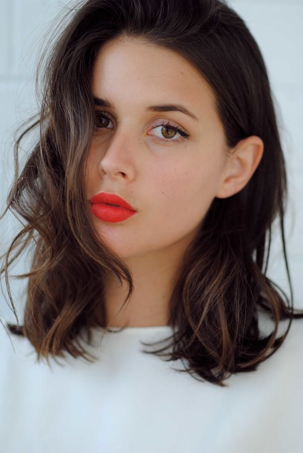Dark brown, wavy mid-length / shoulder length hair