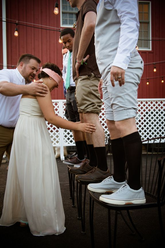 Offbeat wedding games ~ the Italian Knee game! Brittany & Dave's coral & mint, DIY Virginia wedding. Images by Traci J Brooks Studios.