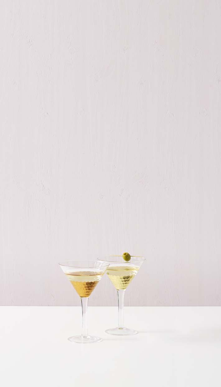 Is it time yet? Celebrate happy hour with this Set of Two Mixed Metallic Martini Glasses.