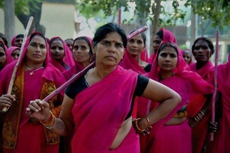 """Gulabi Gang. """"Sampat Devi Pal founded the Gulabi Gang, the women in pink saris who help women in Uttar Pradesh – North of India. Sampat Pal recruits those she helps. There are several thousand women in pink saris.... By joining the Gang, they come to discover in themselves strength and courage. They fight for dignity and for the rights of the humble ones. The Gulabi Gang protects the powerless from those who abuse their power."""""""