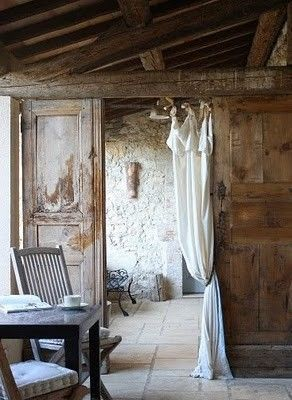 Room divider with reclaimed doors and curtain.