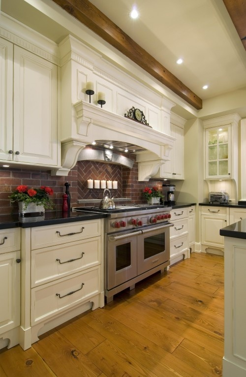 Shelf over stove; Brick backsplash (this one is a little too dark); wood ceiling beams.. I like it all!