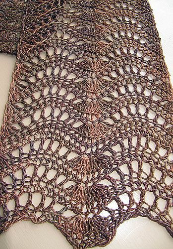 I love the look of knitted Feather and Fan shawls, but I'm such a slow knitter it would take me forever to finish one. So I came up with a crocheted version that has the drape and texture I loved in the knit version. This is not a difficult pattern; just be sure to skip a stitch before you start the center shell.