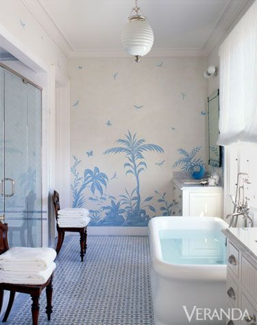 Crisp white and blue, beach house decor, of this bathroom are simple yet functional. Mosaic floor tile by New Ravenna Mosaics.