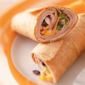 Speedy Lunch Wraps:  Spread cream cheese over tortillas. Layer with turkey, lettuce, cheese, chopped green onion, chopped green pepper and chopped black olives; drizzle with ranch dressing. Roll up tightly; wrap in plastic wrap. Refrigerate until serving.