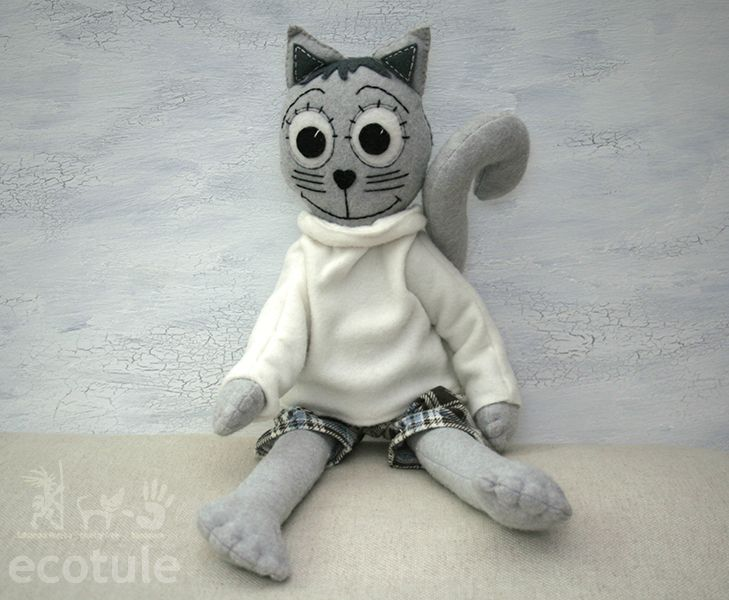 This cat doll is 100% hand made and it's made from felt.  It's nice and soft, perfect for hugging.  I made pants separately from old, recycled material.