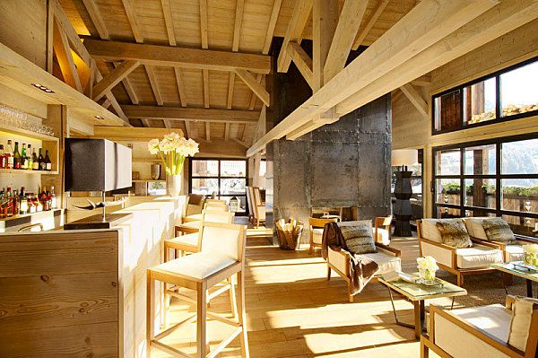 Amazing chalet living room with the industrial stainless fireplace. Alpaga 5* in Megeve.