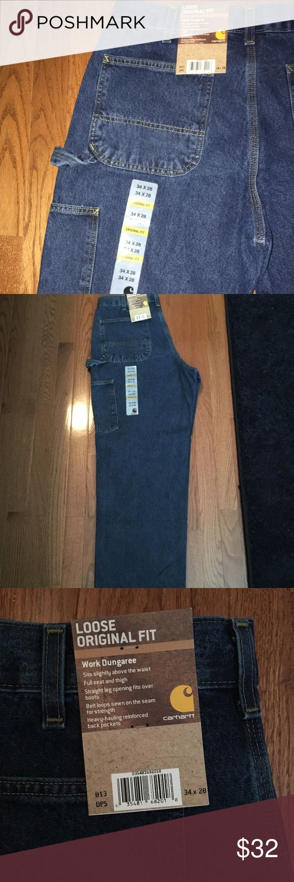 Men's Work Dungaree Jean | 34 x 28 Loose original fit signature denim dungaree jean. PERFECT work jeans. Comfy with LOTS of pockets. These are brand new never worn with tags. Size 34 x 28.  Men's heavyweight durable denim 15-ounce, 100% cotton denim Sits slightly above the waist Full seat and thigh Multiple tool and utility pockets Left leg hammer loop Stronger sewn-on-seam belt loops Carhartt Jeans