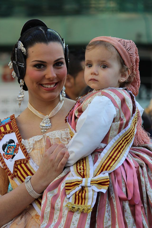 Woman and child dressed in traditional costumes from Valencia region (Spain)