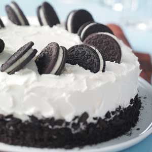 Cookies-and-Cream Cake ~ If you like cookies-and-cream ice cream, you'll love this cake. Chocolate sandwich cookies are mixed into the batter and pressed into the sweet and creamy frosting for a fun look.