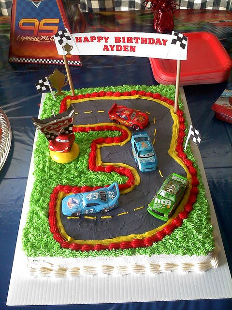 Cars Birthday Cake Idea...could line all the cars up that we already have, plus add a couple new ones.