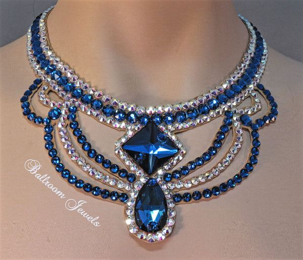This necklace was created with Crystallized™ Swarovski Elements crystals. The necklace has a large pear and square shaped blue crystals in the front with blue a