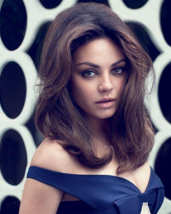 Mila Kunis Hair Elle Magazine- big hair-   The higher the hair, the closer to god! hahaa