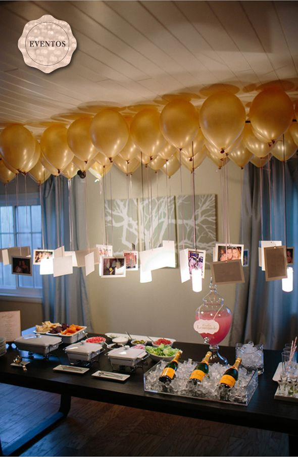 pictures hanging from balloon ribbons