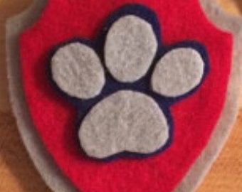 Paw Patrol Zuma Inspired pup tag, looks great as part of a costume! handmade by Smoochie Mamas! Thanks for looking!     ********PLEASE NOTE!!******** I do not claim ownership over the characters or images used, such images are free and are NOT being sold! The price you are paying is for my time creating these items and the materials used. The Copyright solely belong to their respective copyright holders.