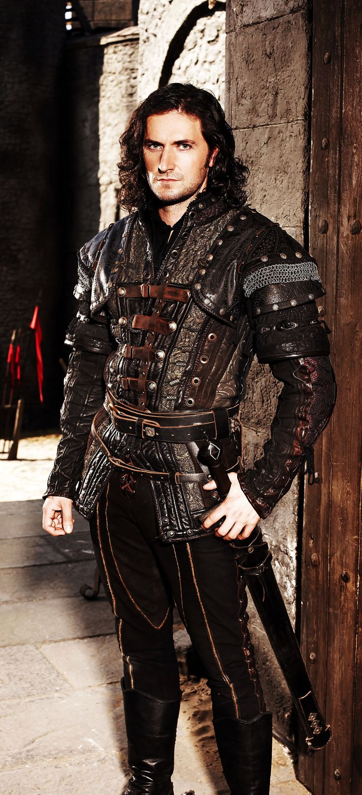Tybalt's masquerade outfit. Make it all black, remove the sword, add a couple of hidden daggers. Maybe some black wolf fur.