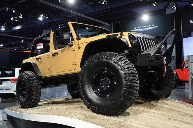 """Jeep Wrangler Sand Trooper . . hard-core Jeep parts including axles, lift kits, bumpers, winches, skid plates and suspension components,"""" says the company – Jeep has unveiled the Wrangler Sand Trooper that you see above.    Included in the upgrade list is a 5.7-liter Hemi engine conversion, portal axles, eight-lug beadlock wheels and a full underbody skidplate. Body bits consisting of half doors, a vented hood, flat fenders, a massive front bumper fitted with a Warn winch"""
