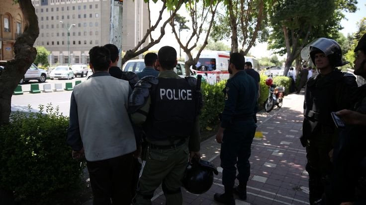 The Associated Press   Several attackers stormed into Iran's parliament and a suicide bomber targeted the shrine of Ayatollah Ruhollah Khomeini on Wednesday, killing a security guard and wounding 12 other people in rare twin attacks, with the shooting at the legislature still... - #Attacks, #Iran, #Khomeini, #Leave, #News, #Parliament, #Shrine, #Twin