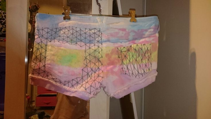 Shorts diy. Drawn on with silver sharpie. Dyed useing dip dye and masking tape as base. Then pined tucks into fabric and sprayed with dye. Took out pins and sprayed lightly with bleach and washed out after a few seconds to lighten dye. Washed then drew on them.