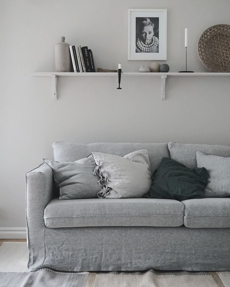 Grey Scandinavian inspired living room | grey linen sofa | simple yet perfectly styled bookshelf | Swedish photographer and stylist @baravickan updated her IKEA Karlstad sofa with a Bemz Loose Fit Urban cover in Graphite Brera Lino linen