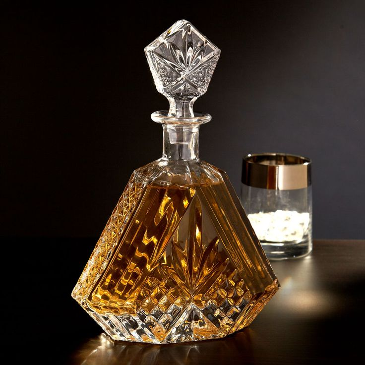 Present your fine whiskey with the stylish elegance of our crystal decanter. This whiskey decanter is crafted into a delicate triangular shape, and the cut allows the amber glow of your favorite whiskey...