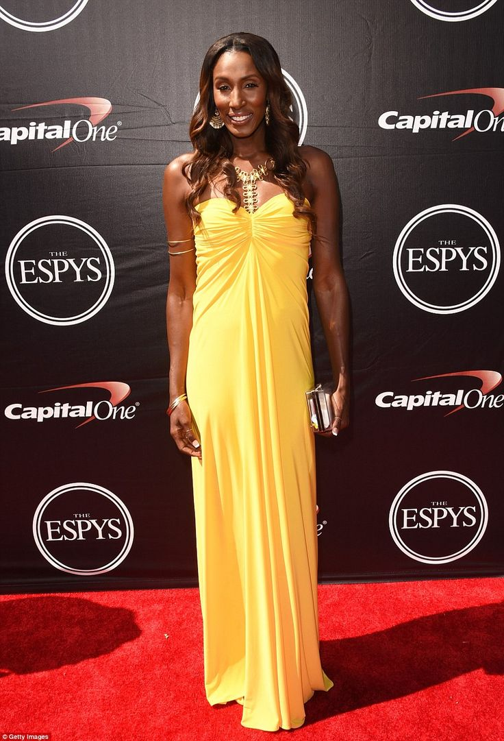 Lovely in lemon: Former WNBA player Lisa Leslie had a feminine look in a long line yellow ...