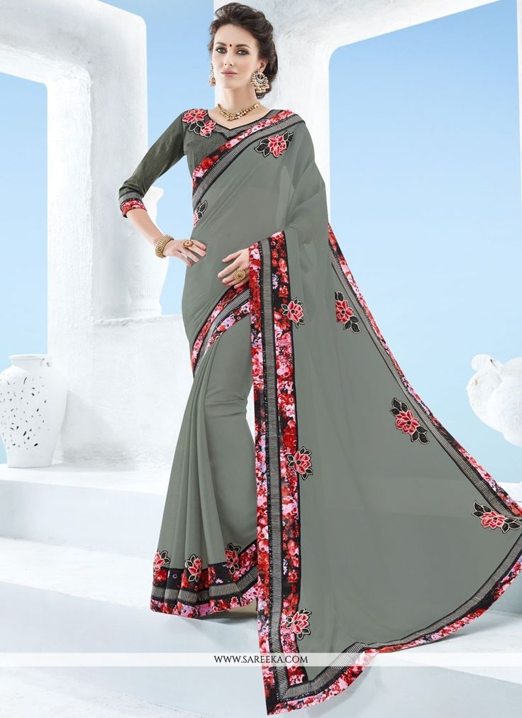 This delightful diva accoutre features unique styling and unusual material. Women magnificence is magnified tenfold in this alluring grey faux chiffon classic designer saree. The ethnic embroidered an...