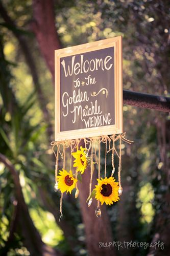 Chalkboard welcome sign with sunflowers. Delmar Events - Wedding Planner - Los Angeles - Wedding.com