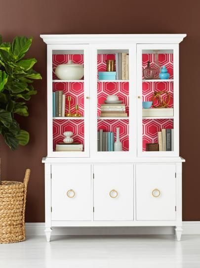 White cabinet / red patterned wallpaper inside || Update a Used China Cabinet | HGTV