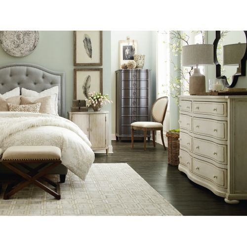 Ivory, gray and blue go perfectly together! Combine them with dark floors for a chic bedroom. Get these pieces and more during the Bassett Furniture Sale, going on now at Woodchucks.