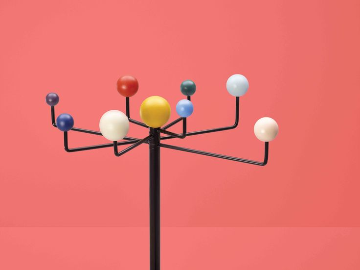 """Orbit coat rack by Kvell. Nostalgic and fun, this mid century throw back is both a clever and functional coat rack for your home. Assembles in minutes with no tools required, the Orbit has 2 height settings (40"""" or 60"""") and moving arms for a custom layout. Orbit comes in a fun array of planetary colors and a neutral black or white palette."""