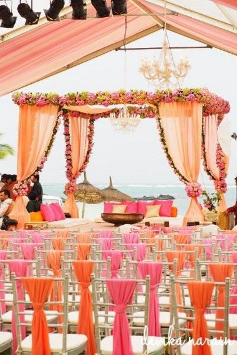 Mandap option 3 - we like the design but would want different colours (e.g. light pink with red & orange flowers). We also like the chair covers.