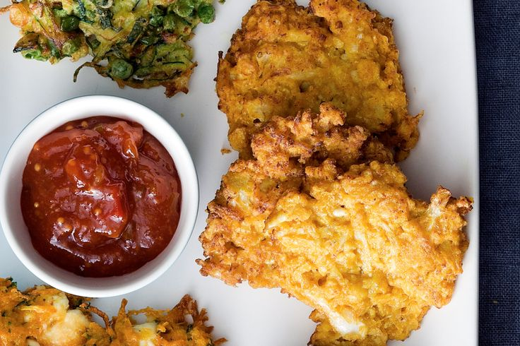 Add these cauliflower fritters to your finger food spread as a delicious vegetarian option.