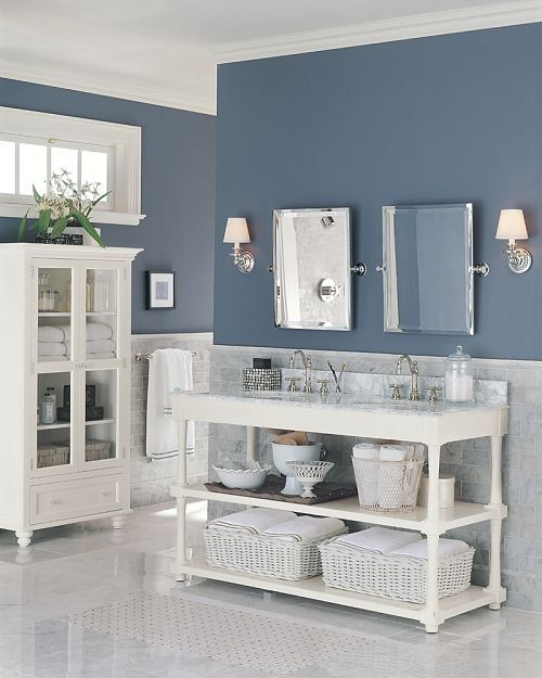 Slate-blue walls provide the color in this master bath. I like the open area under the sinks too ... http://www.bathroom-paint.net/bathroom-type.php